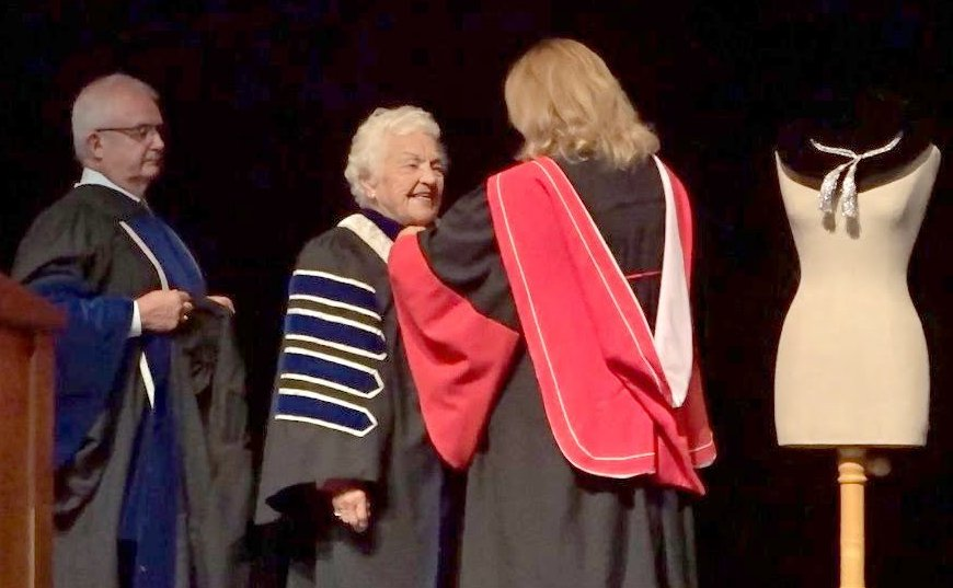 Dr. Mary Preece puts Chancellor's robe on Hazel McCallion